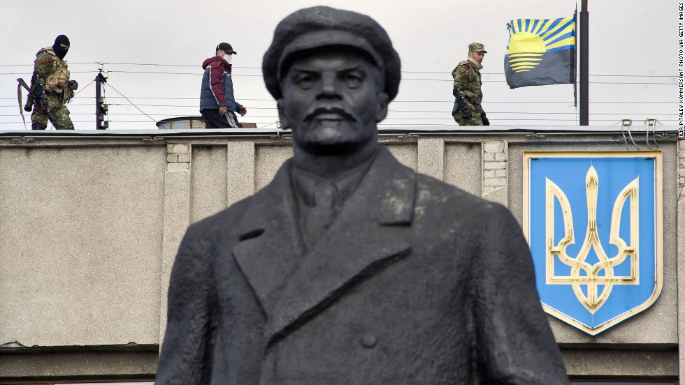 Armed pro-Russian activists stand guard on top of a Ukrainian regional administration building in Slovyansk on Monday, April 14.