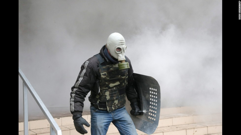 A pro-Russian activist carries a shield during the mass storming of a police station in Horlivka, Ukraine, on April 14.