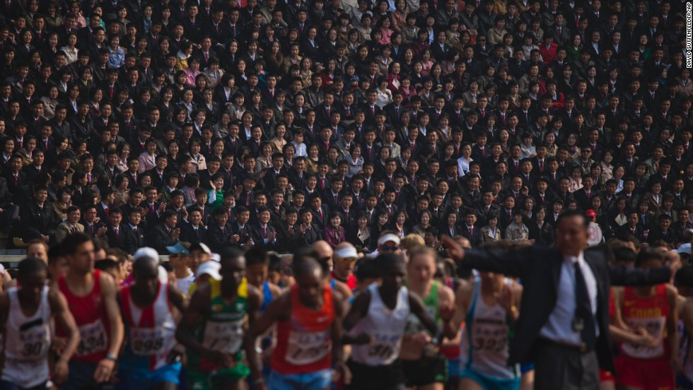 Spectators watch from the stands of Pyongyang's Kim Il Sung Stadium on April 13 as runners line up at the start of the North Korean capital's annual marathon.