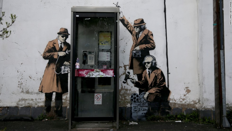 Banksy's work often plays with overtly political themes such as surveillance culture and state corruption.