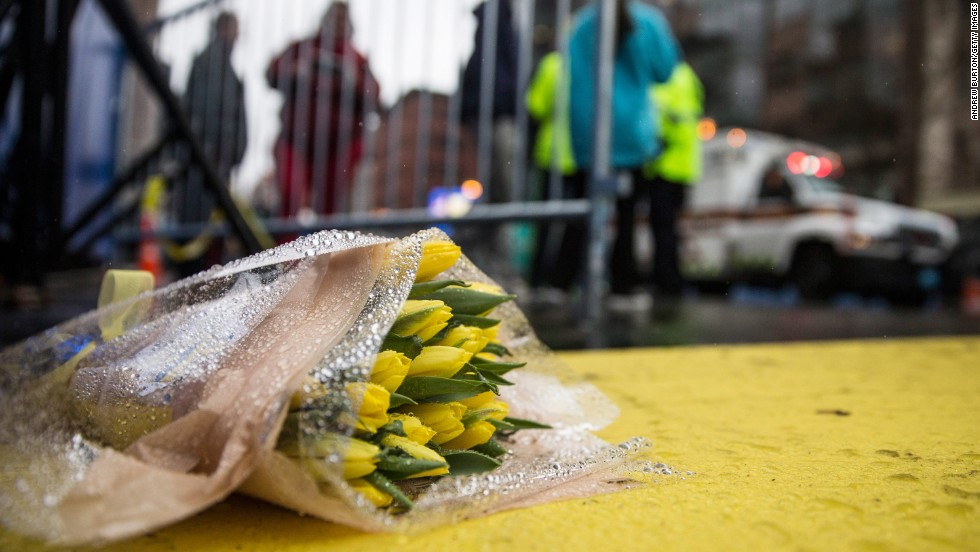 Flowers lie on the finish line of the Boston Marathon. The annual race will take place next Monday, April 21.