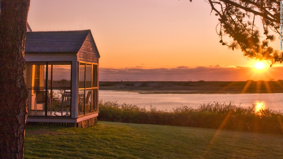 The 12-acre Dunes on the Waterfront, in Ogunquit, Maine, has 17 rooms, each with a pair of Adirondack chairs, as well as 19 cottages with their own screened-in porches. The beach is just across the river.