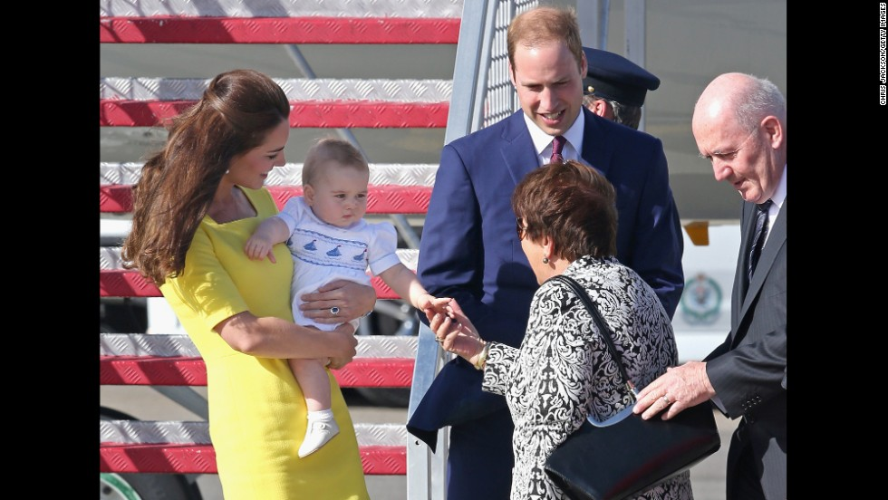 Lynne Cosgrove, wife of Australia's governor-general, greets Britain's royal couple and Prince George at Sydney Airport on April 16.