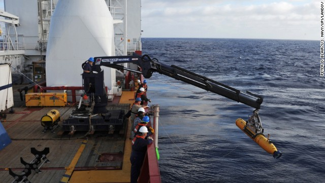 Operators aboard the Australian ship Ocean Shield move the U.S. Navy's Bluefin-21 autonomous underwater vehicle into position for deployment in the Indian Ocean on Monday, April 14.