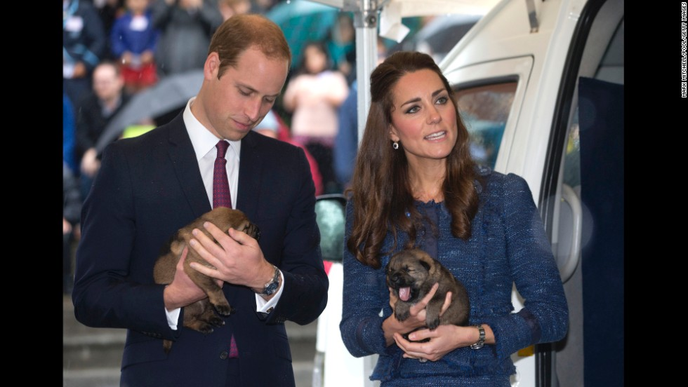 The royal couple hold puppies during a visit to the Royal New Zealand Police College in Wellington, New Zealand, on April 16.