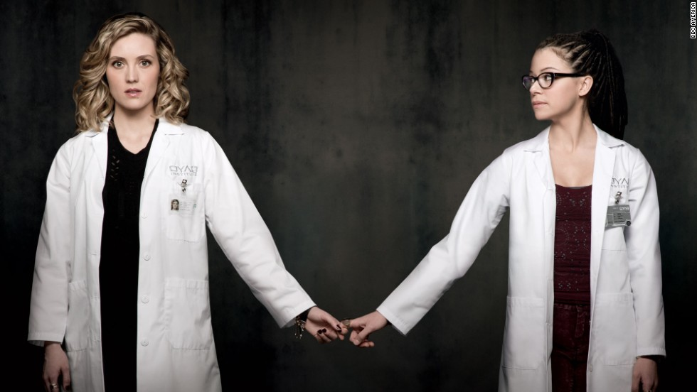 Everyone's favorite scientist, Cosima Niehaus, is brilliant, geeky and has an open mind when it comes to using a certain herbal remedy. She has found love with fellow scientist Delphine (Evelyne Brochu, left), but can't completely trust her.