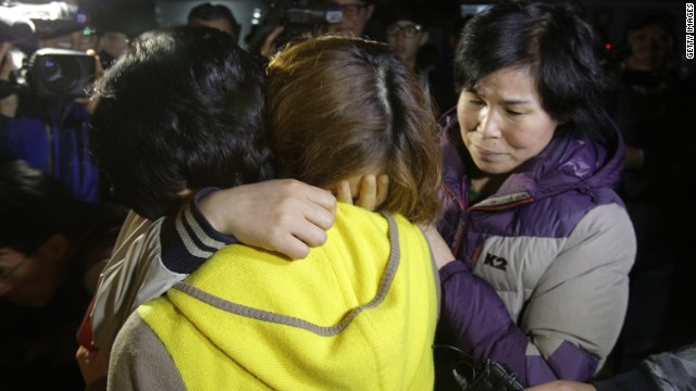 Relatives weep as they wait for missing passengers of a sunken ferry at Jindo port on April 16, 2014 in Jindo-gun, South Korea.