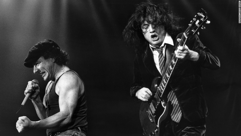 """Brian Johnson and Angus Young perform in Leiden, Netherlands, in 1991. Johnson took over as lead singer and sang on AC/DC's biggest hits, including """"Back in Black"""" and """"You Shook Me All Night Long."""""""