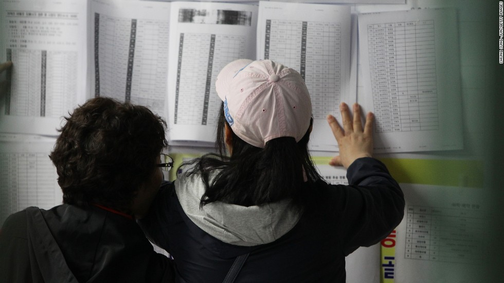 Relatives check a list of survivors April 16 in Jindo.