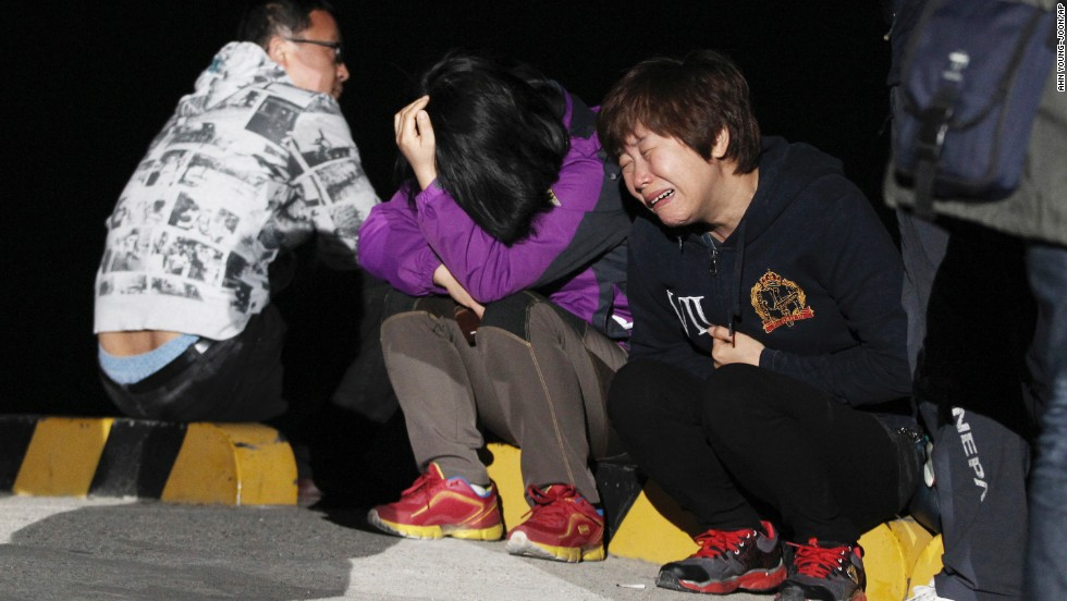 A relative of a passenger cries as she waits for news on Wednesday, April 16.