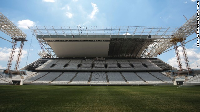 Picture taken on January 20, 2014 showing the damages (L) cause when a crane fell across part of the metallic structure of the Arena de Sao Paulo stadium --Itaquerao do Corinthians-- almost two months ago, and which is still under construction, in Sao Paulo, Brazil. The Sao Paulo Arena Corinthians, which is due to hold the opening match of the Brazil 2014 FIFA World Cup between Brazil and Croatia on June 12, will only be ready in mid-April following an accident in November which killed two construction workers. The fatal accident has put back pre-tournament testing until mid-April. AFP PHOTO / Miguel SCHINCARIOL (Photo credit should read Miguel Schincariol/AFP/Getty Images)