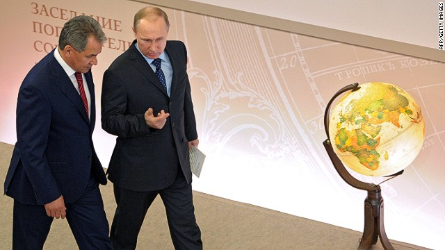 Russian President Vladimir Putin (R) and Russian Defence Minister Sergei Shoigu (L) walk to take part in a meeting of the council of trustees of the Russian Geographical Society (RGS) in the main library of the State University in Moscow on April 15, 2014. AFP PHOTO / RIA NOVOSTI / PRESIDENTIAL PRESS SERVICE / ALEXEY DRUZHININALEXEY DRUZHININ/AFP/Getty Images