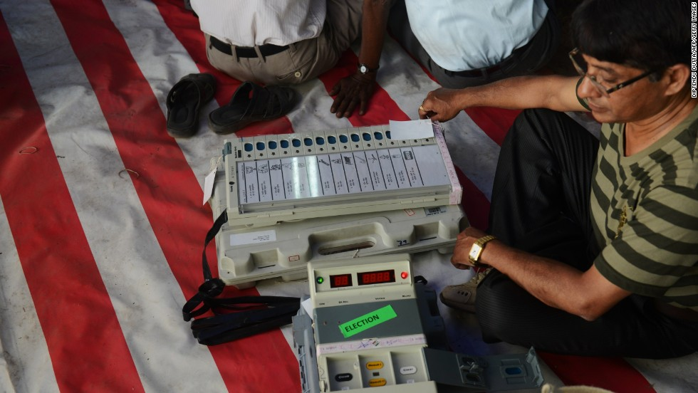 An election official checks an electronic voting machine before taking it to polling stations at a distribution center in Siliguri, India, on Wednesday, April 16.