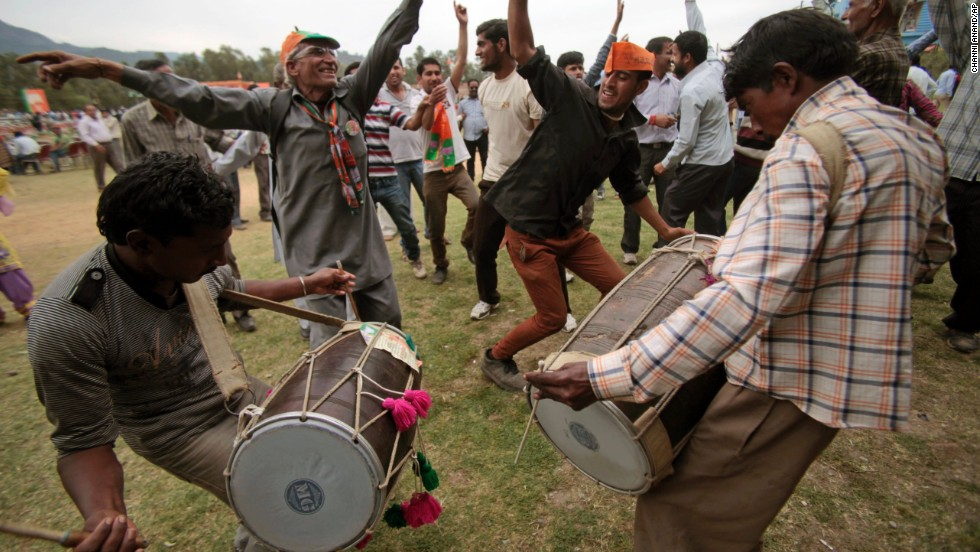 Supporters of India's main opposition Bharatiya Janata Party dance during a campaign rally in Udhampur on April 15.