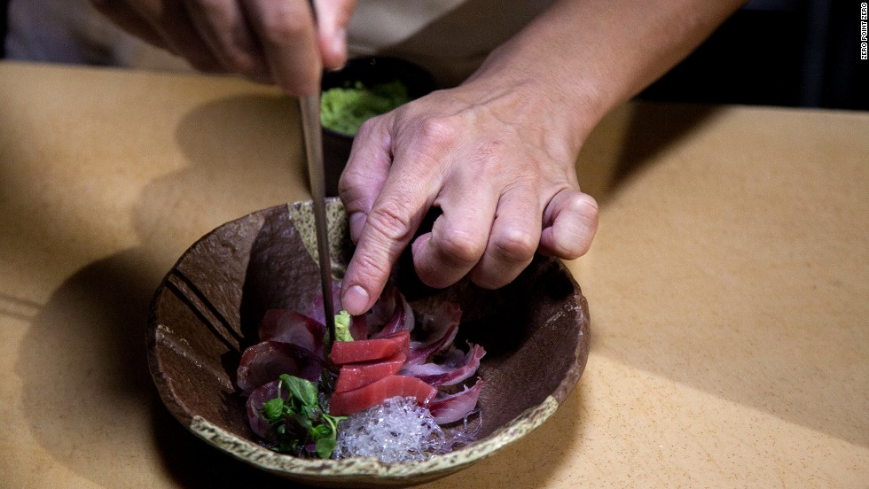 Chef Mitsuo Endo puts the finishing touches on a dish at Raku.