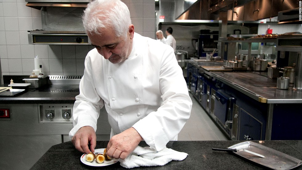 French chef Guy Savoy prepares a plate at his namesake restaurant.