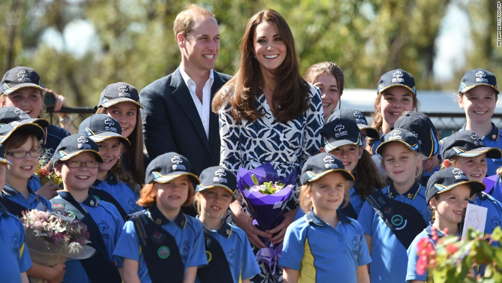 The duke and duchess join Girl Guides after planting a tree Thursday, April 17, in Winmalee, Australia, an area heavily affected by recent bush fires.