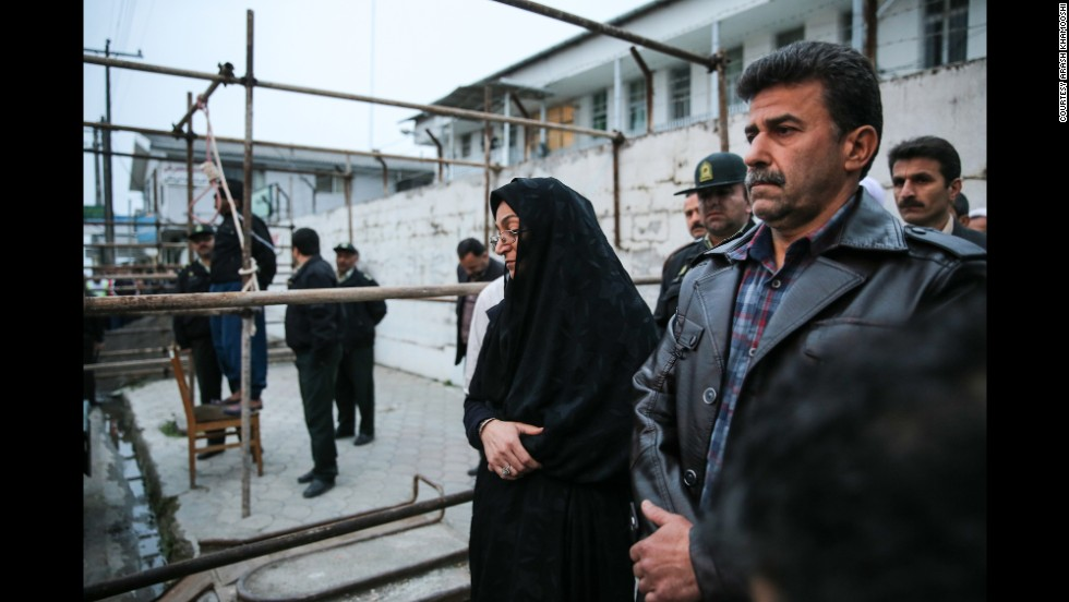 Maryam and Abdulghani Hosseinzadeh, the victim's parents, stand next to the execution platform as Balal is prepared to be hanged.