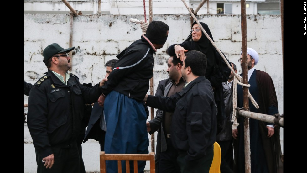 Maryam Hosseinzadeh, standing on a chair, slaps Balal.