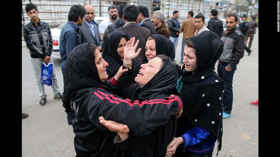 Balal's family embraces after the execution was halted.