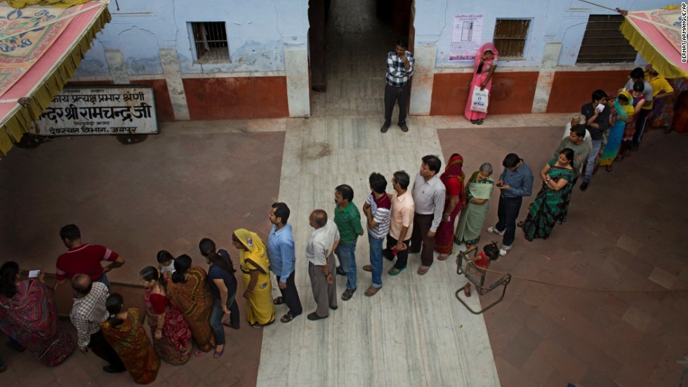 People stand in line to cast their votes in Jaipur on April 17.