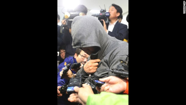 Lee Joon-seok, the captain of the Sewol, arrives at the Mokpo Police Station in Mokpo, South Korea, on April 17.