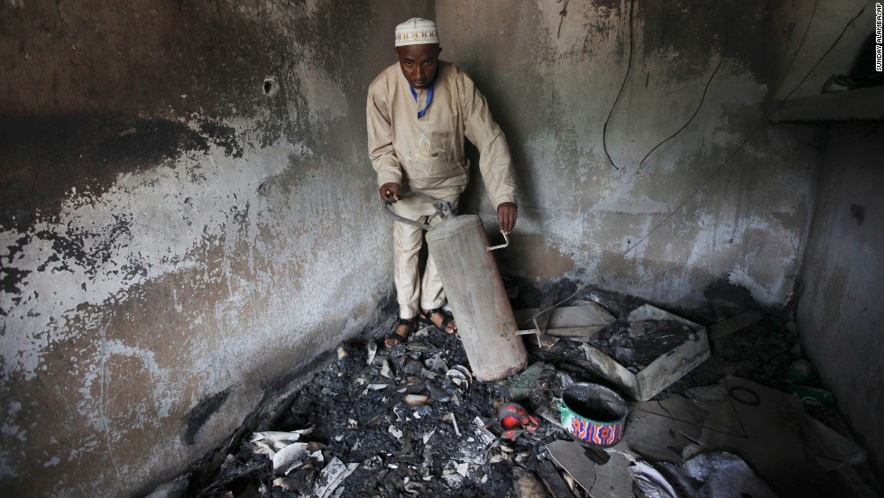 "An official displays burned equipment inside a prison in Bauchi, Nigeria, on September 9, 2010, after the prison was attacked by suspected members of Boko Haram two days earlier. About <a href=""http://www.cnn.com/2010/WORLD/africa/09/08/nigeria.prison.break/index.html"">720 inmates escaped</a> during the prison break, and police suspect the prison was attacked because it was holding 80 members of the sect."