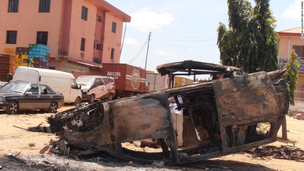 A photo taken on June 18, 2012, shows a car vandalized after three church bombings and retaliatory attacks in northern Nigeria killed at least 50 people and injured more than 130 others, the Nigerian Red Cross Society said.