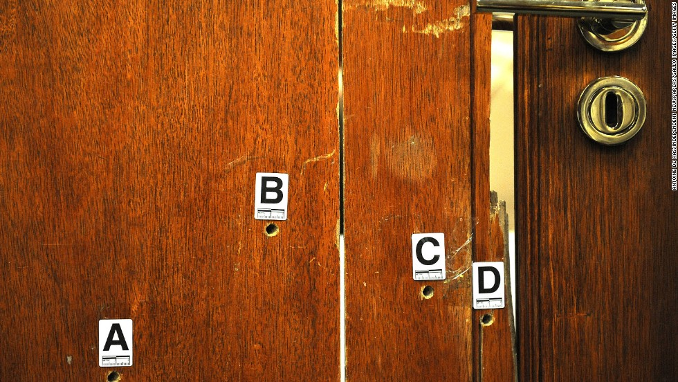 "The door through which Oscar Pistorius fatally shot his girlfriend, Reeva Steenkamp, is used as evidence during <a href=""http://www.cnn.com/2014/03/03/africa/gallery/pistorius-2014-trial/index.html"">his murder trial</a> Monday, April 14, in Pretoria, South Africa. Pistorius, the first double amputee runner to compete in the Olympics, is accused of intentionally killing Steenkamp in February 2013. He has pleaded not guilty to murder and three weapons charges."