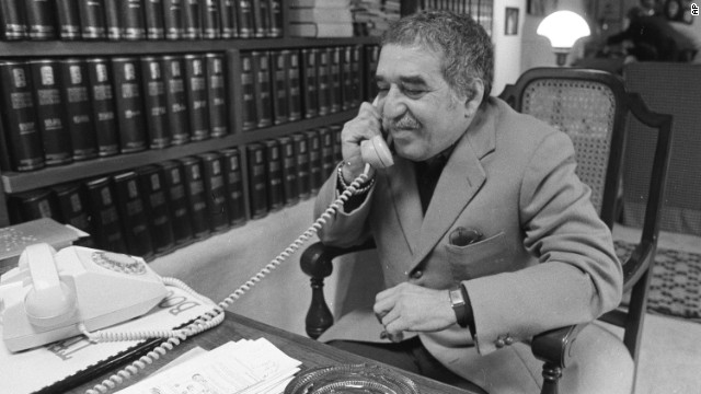 """García Márquez, a native of Colombia, talks on the phone at his home in 1982. He is widely credited with helping to popularize the """"magic realism"""" genre."""