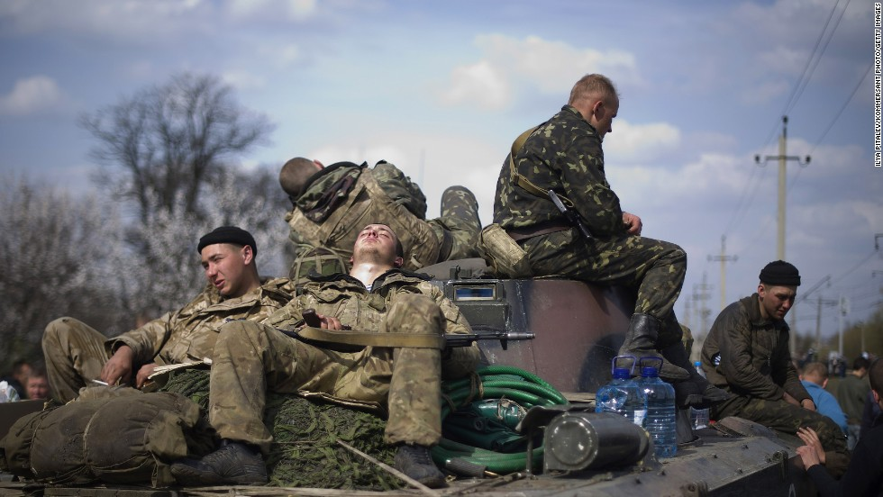 "Ukrainian soldiers rest near the eastern Ukrainian town of Kramatorsk on Wednesday, April 16. Ukraine has seen a sharp <a href=""http://www.cnn.com/2014/03/26/world/gallery/ukraine-crisis/index.html"">rise in tensions</a> since a new pro-European government took charge of the country in February. Moscow branded the new government illegitimate and annexed Ukraine's Crimea region last month, citing threats to Crimea's Russian-speaking majority. And in eastern Ukraine, pro-Russian separatists have seized government and police buildings in as many as 10 towns and cities."