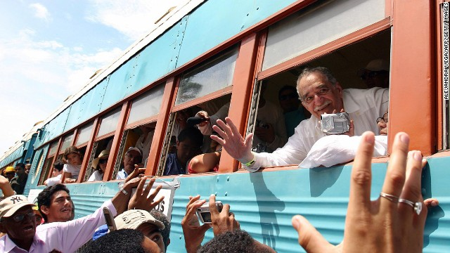 García Márquez waves out the window of a train in 2007 upon his arrival at his hometown of Aracataca, Colombia. It was his first visit in 20 years.