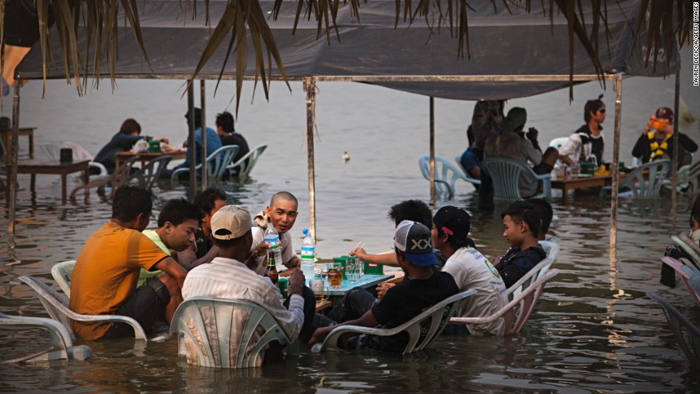 Burmese teenagers sit at a restaurant near Kandawgyi Lake during Thingyan, the Buddhist water festival leading up the Burmese New Year, on Wednesday, April 16. During the festival, staying dry is a rarity. Water symbolizes the washing away of the previous year's bad luck and sins.