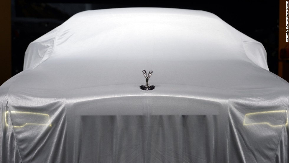 The Rolls-Royce Ghost Series II waits to be unveiled at the New York International Auto Show on Wednesday, April 16. The auto show is open April 18-27 at the Jacob Javits Center in New York City.