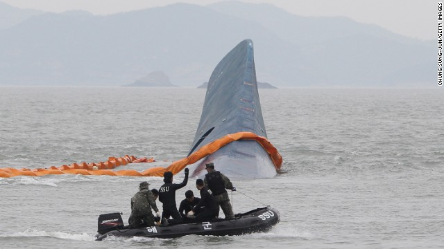 Memebers of the South Korean Navy search for missing passengers at the site of the sunken ferry off the coast of Jindo Island on April 17, 2014 in Jindo-gun, South Korea.
