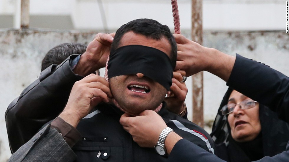 "The parents of Abdollah Hosseinzadeh remove a noose from the neck of his convicted killer, a man identified only as Balal. Balal killed Hosseinzadeh during a street fight in 2007, according to the semi-official Iranian news agency ISNA. But just seconds before Balal was to be hanged in public this week, <a href=""http://www.cnn.com/2014/04/17/world/meast/iran-execution-photos-mother-forgives/index.html"">he was forgiven</a> by Hosseinzadeh's mother."
