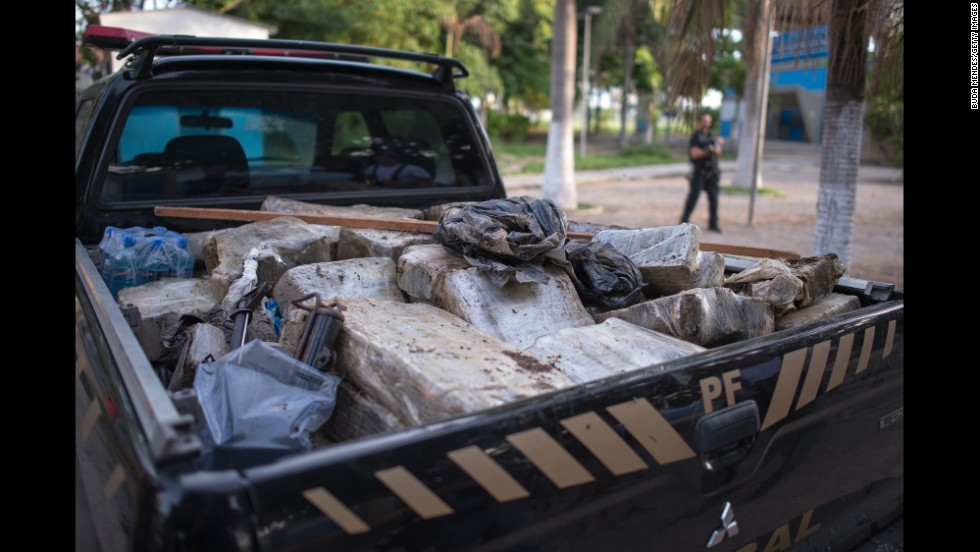 "Drugs found by Brazilian federal police officers fill the back of a truck. Similar ""pacification"" programs have been staged in Rio's other favelas."