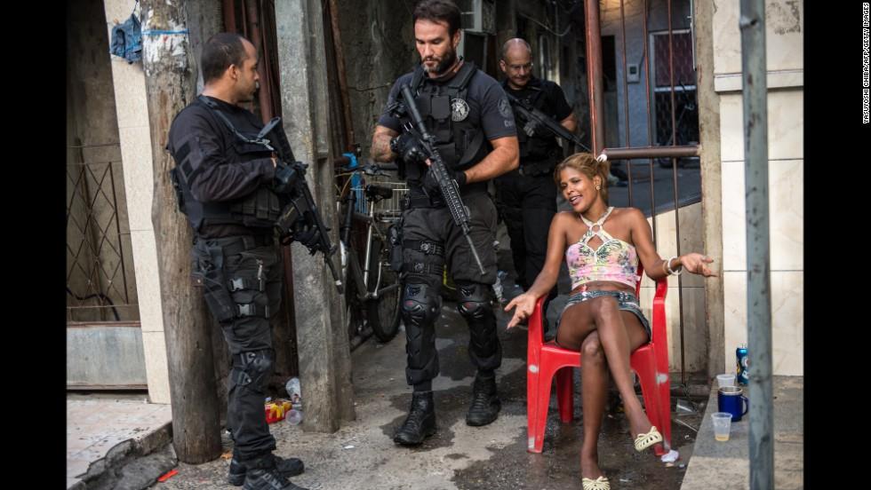 Police patrol the favela in Rio de Janeiro on March 30.
