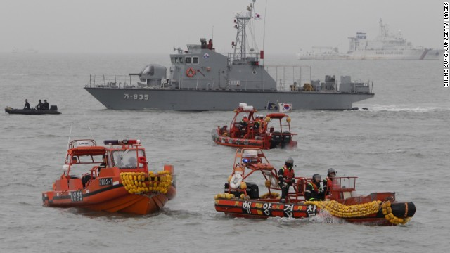 Caption:JINDO-GUN, SOUTH KOREA - APRIL 17: South Korean Coast Guard and rescue teams search for missing passengers at the site of the sunken ferry off the coast of Jindo Island on April 17, 2014 in Jindo-gun, South Korea. At least six people are reported dead, with 290 still missing. The ferry identified as the Sewol was carrying about 470 passengers, including students and teachers, traveling to Jeju Island. (Photo by Chung Sung-Jun/Getty Images)