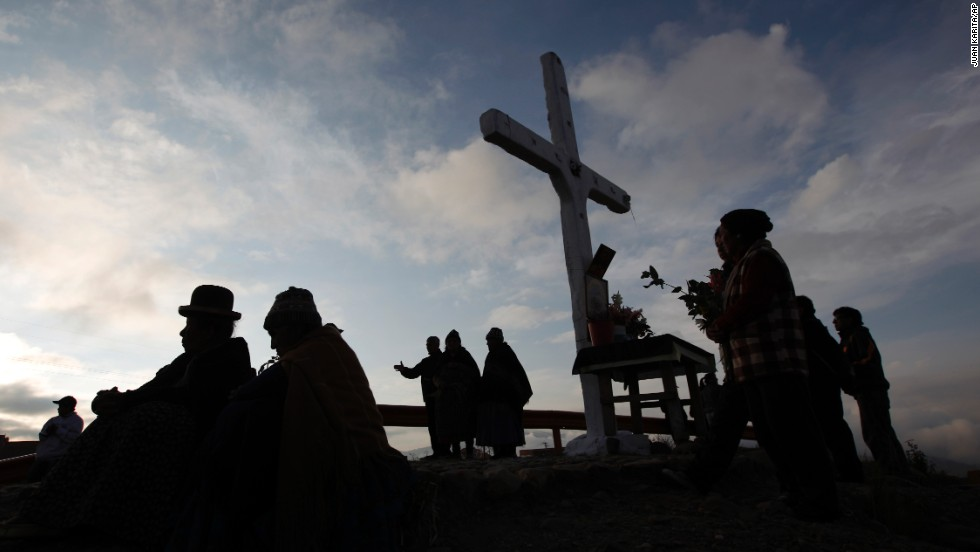 Faithful take part in a pilgrimage to the Cross of Villa Armonia during a possession to mark Good Friday in La Paz, Bolivia.