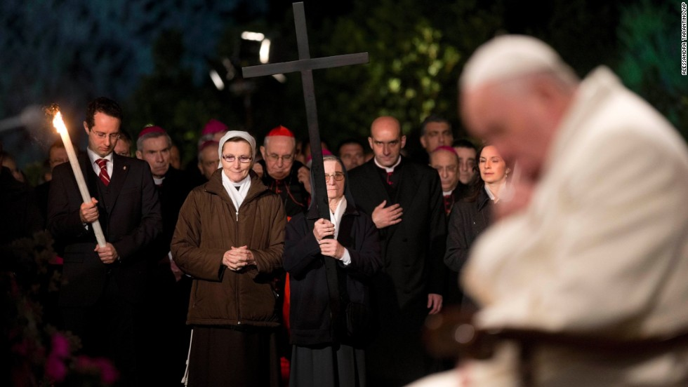Pope Francis prays during the Stations of the Cross ceremony at the Colosseum in Rome on April 18.