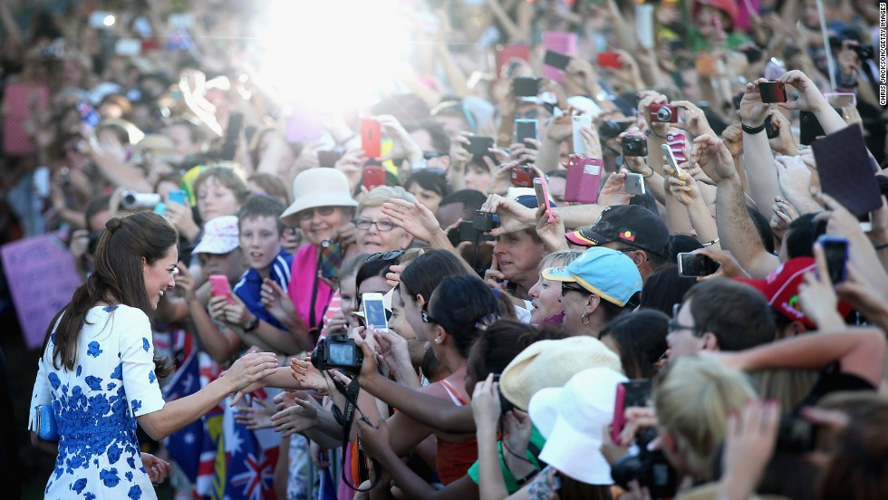 Large crowds cheer and try to catch a glimpse of the duchess on the South Bank in Brisbane, Australia, on April 19.