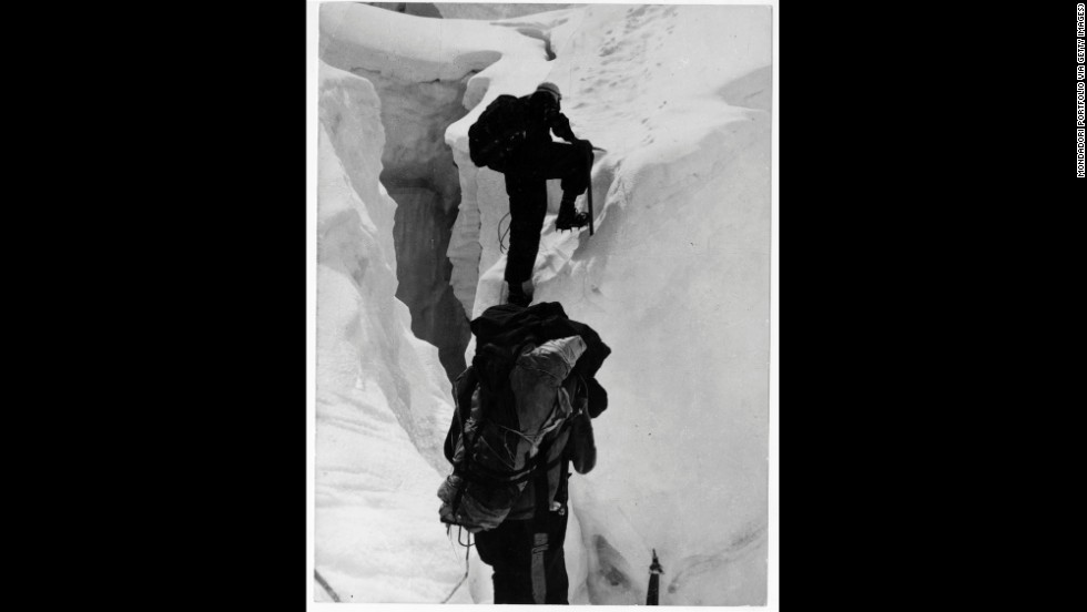 "Hillary and Nepalese-Indian mountaineer Tenzing Norgay climb beyond a crevasse on Mount Everest in 1953. Upon meeting George Lowe, who had climbed up to meet the descending duo, Hillary reportedly exclaimed, ""Well George, we knocked the bastard off!"""