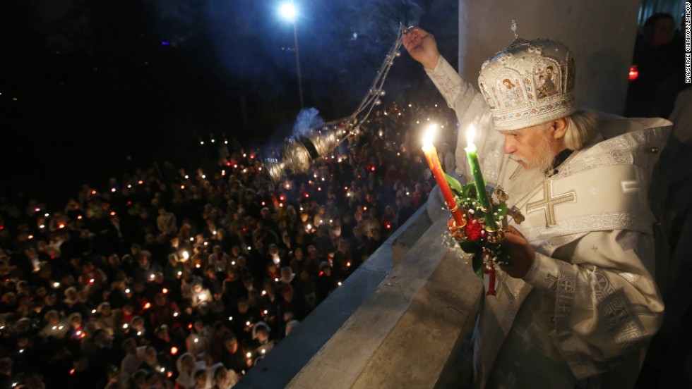 Russian Orthodox Bishop Panteleimon spreads incense during a cross procession at the Church of Christ's Resurrection in Moscow.