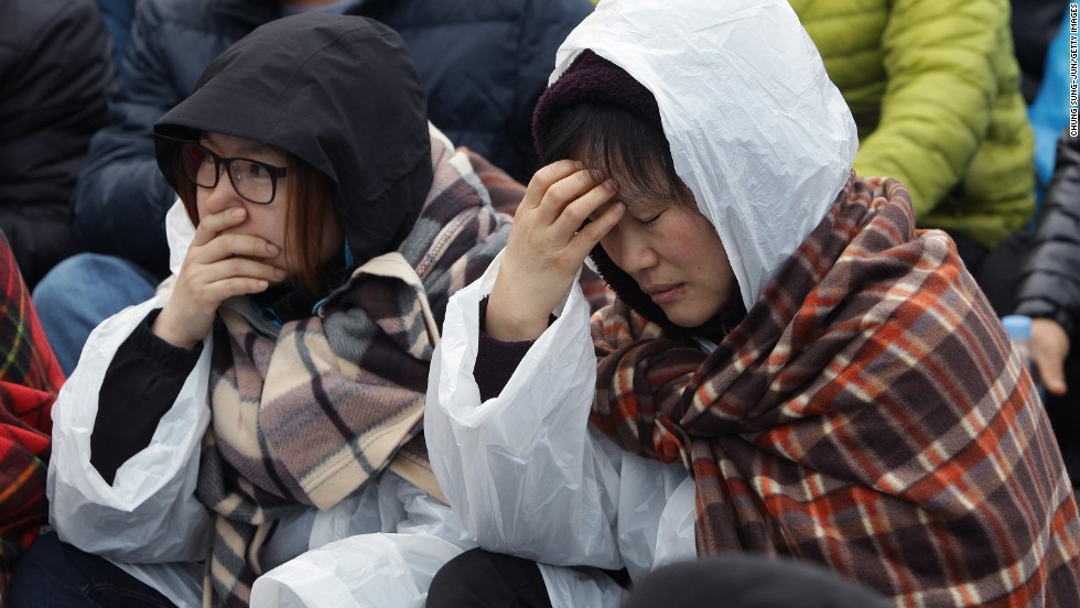 Relatives of missing passengers grieve April 20 in Jindo.