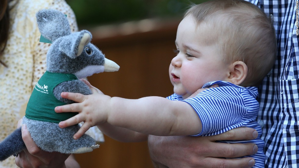 Prince George of Cambridge reaches for a stuffed toy during a visit to Sydney's Taronga Zoo on April 20. The toy represents a bilby, an Australian marsupial on the verge of extinction. The zoo named its Prince George Bilby Exhibit soon after the prince's birth in July 2013.