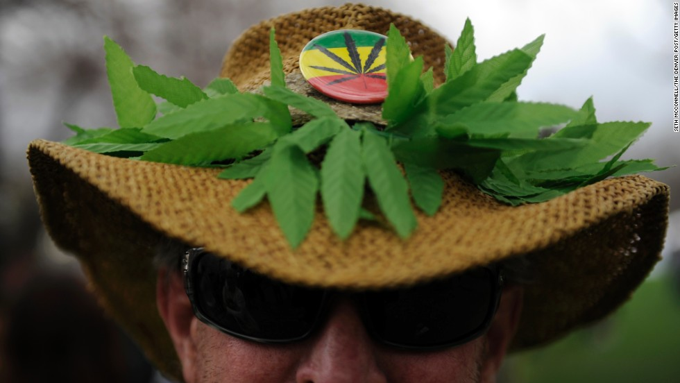 """Chaz"" shows off his marijuana themed hat in Denver on April 19."