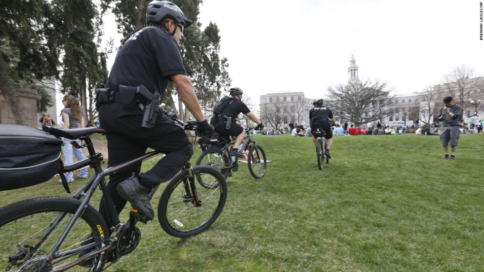 Police officers on bikes patrol Denver's Civic Center Park on April 19, the first day of the festival.