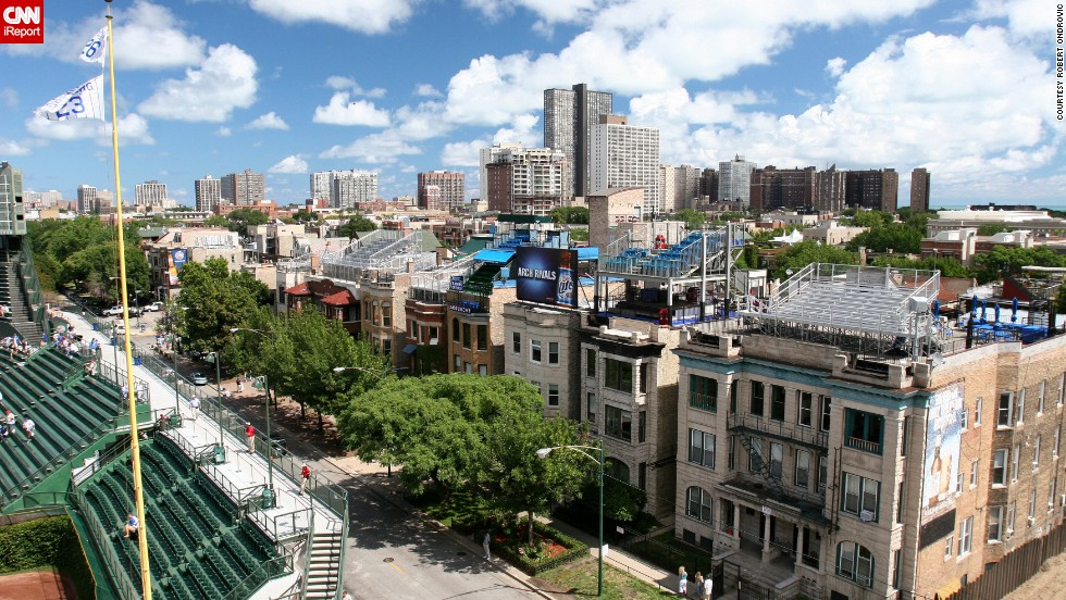 """Ondrovic also photographed houses in Wrigleyville, the neighborhood that surrounds the ballpark. Several residential buildings surrounding the park have <a href=""""http://www.ballparkrooftops.com/"""" target=""""_blank"""">bleachers on their rooftops</a>."""