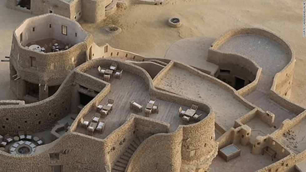 This extraordinary eco-lodge, built from salt rock and mud, sits in the middle of the Saharan oasis at Siwa, eight long, dusty hours' drive from Cairo.